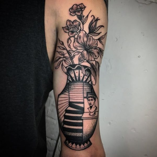 Surrealist Vase tattoo on arm