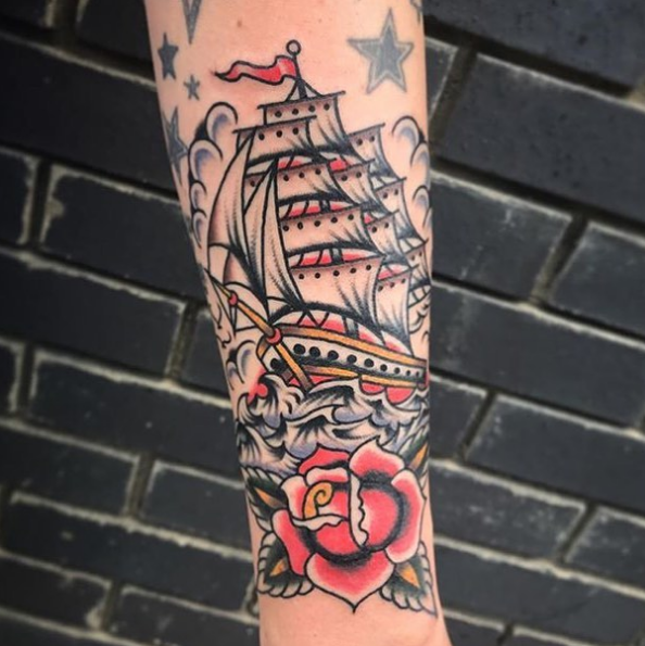 Sailboat & Rose tattoo on arm
