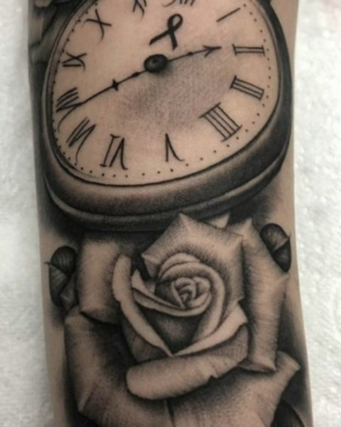 Pocket watch & Rose tattoo on arm