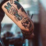 "Tattoo on man's forearm saying ""Work Hard"""
