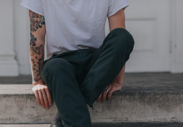 man with tattoos on arm