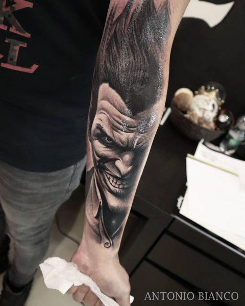the joker tattoo on arm