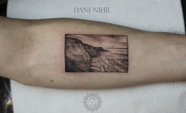 Realistic landscape tattoo on arm