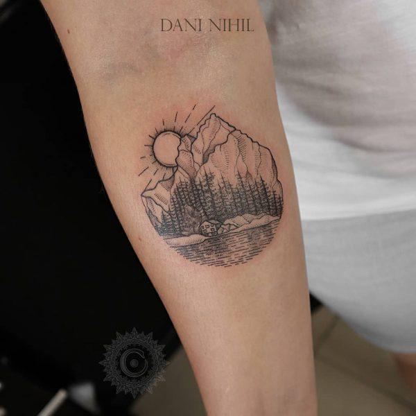 Mountain scene fine line tattoo on arm